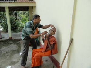 Dr.Upul Ekanayake during a 'Gilanopasthana program' at Keembi ela monastery